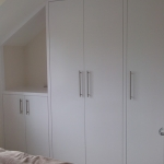 Bedroom wardrobes and TV shelf