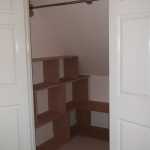 Shelving and hanging rail in under eaves cupboard