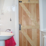 Ledge and braced bathroom door