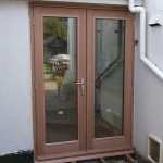Double doors leading to decking area